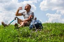 Man with prosthetic leg resting