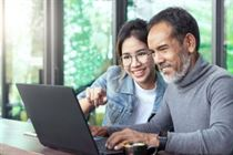 Mature-Asian-man-using-laptop-sm