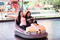 Young women in bumper car