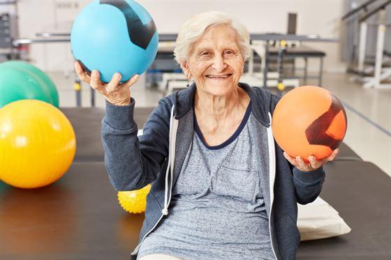Elderly woman playing sports